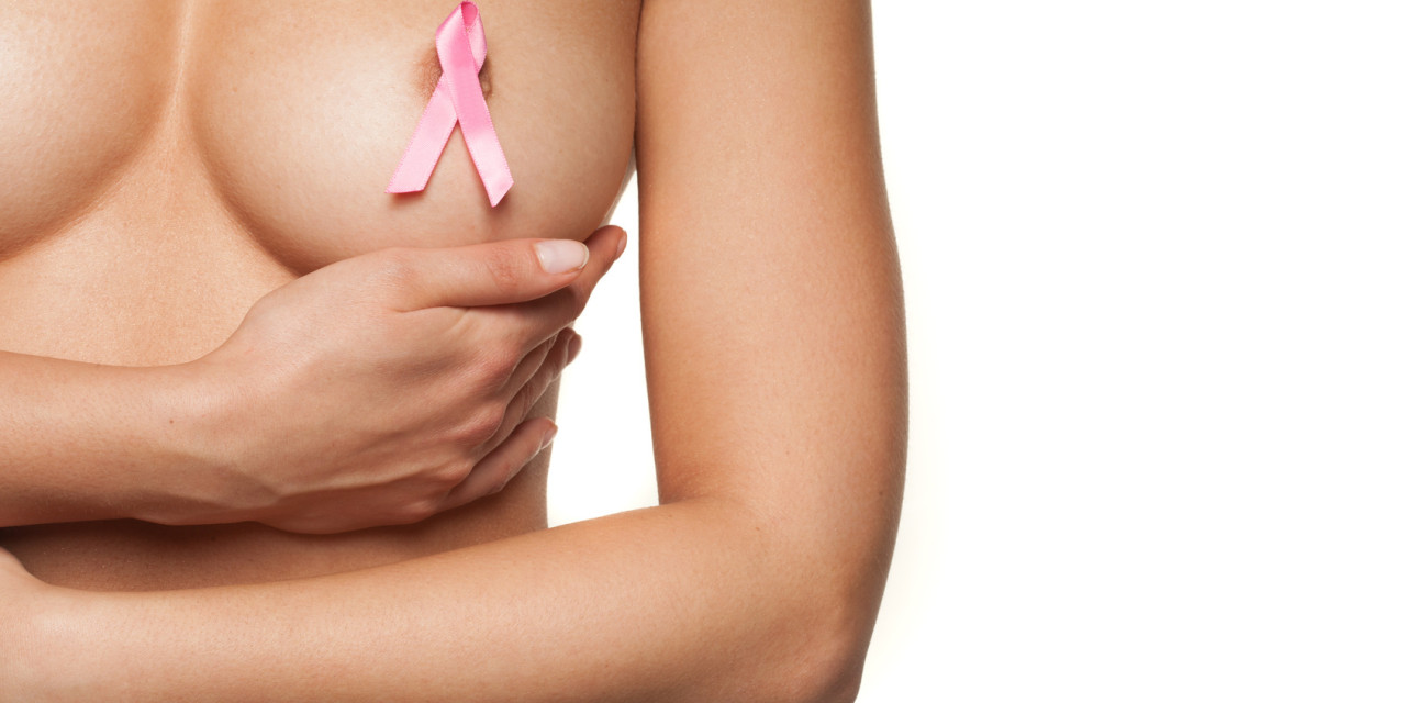 Naked woman wearing a pink breast cancer ribbon